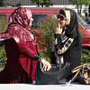 Malden, Ma. 9-17-17. Lala Mhomled left,  Amani Ibrahim, right, chatting at the second annual Malden Muslim festival