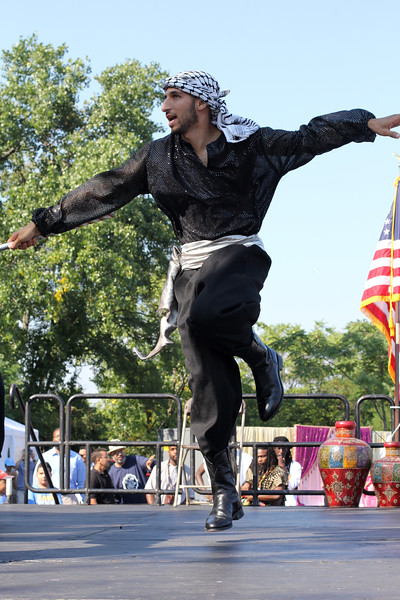 Malden, Ma. 9-17-17. Mohammad Shalodi, the front man for the Freedom Dabka Group performing at the secon annual Malden Muslim festival.