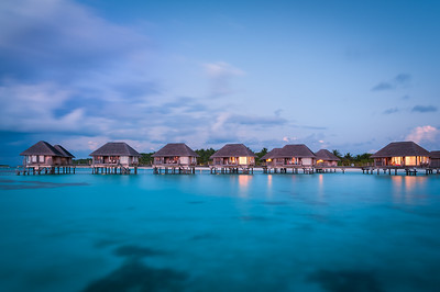 Maldivian water bungalows at dusk