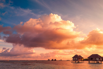 Sunrise over water bungalows in Maldives