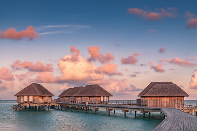 Wonderful golden hour at tropical beach resort in Maldives