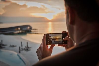 Capturing the sunset at St. Regis Maldives.