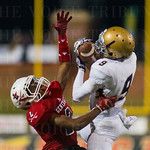 Male\'s Z Smith (9) reeled in a catch under pressure from Lafayette\'s Rickey Johnson (2).