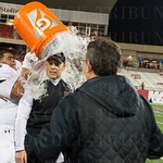 Isaiah Arnold (76) gave coach Chris Wolfe a victory splash with the water cooler.