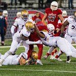 Male\'s Stephon Mayes (45) and Andrew Arnold (53) dropped Lafayette\'s Mason Alstatt (1) for a loss.