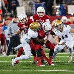 Lafayette QB Walker Wood (9) carried the ball, only to be stopped by Male\'s Demetrius Holt (4).