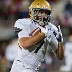 Ethan Britt (7) ran for a Male touchdown.