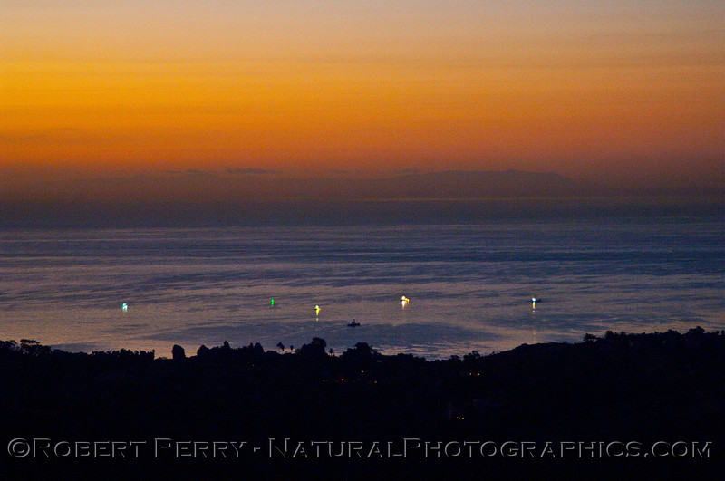 The green indicates lights being extinguished as dawn approaches the commercial market squid boats.