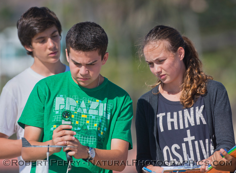 Students measure wind speed.