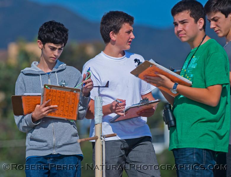 Students measure environmental data.
