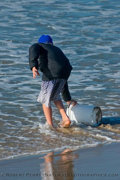student gets water bucket sample 2013 01-10 Zuma-005