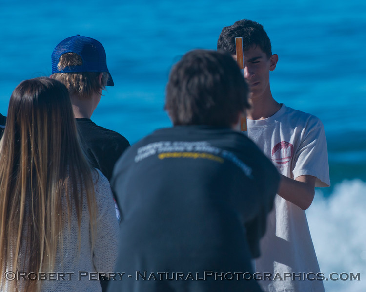 Student researchers (Aaron, Stephie, Mateo and Winston) profile the beach contours.