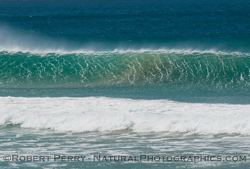 A sparkling Zuma Beach wave with moderate offshore winds.