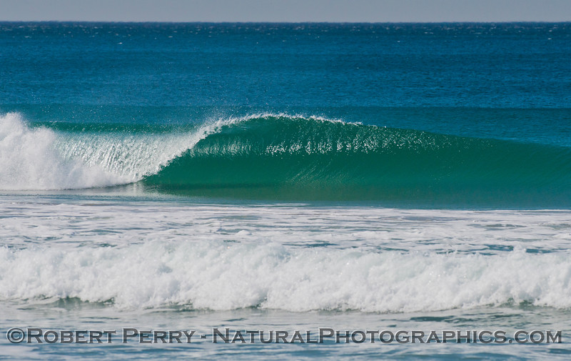 A sparkling Zuma Beach wave with light offshore winds.