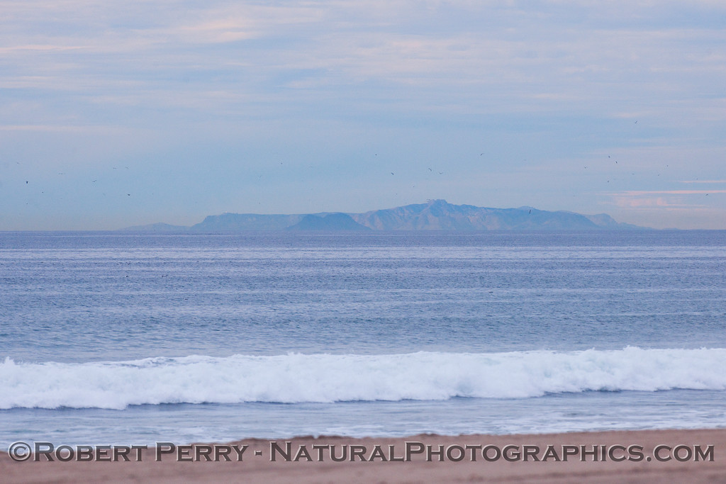 View from Zuma:  Tiny Anacapa Island is the small, dark island in the middle, and big ol' Santa Cruz is everything else.  If you look closely you can see the radar dome on top of Blue Banks Anchorage.