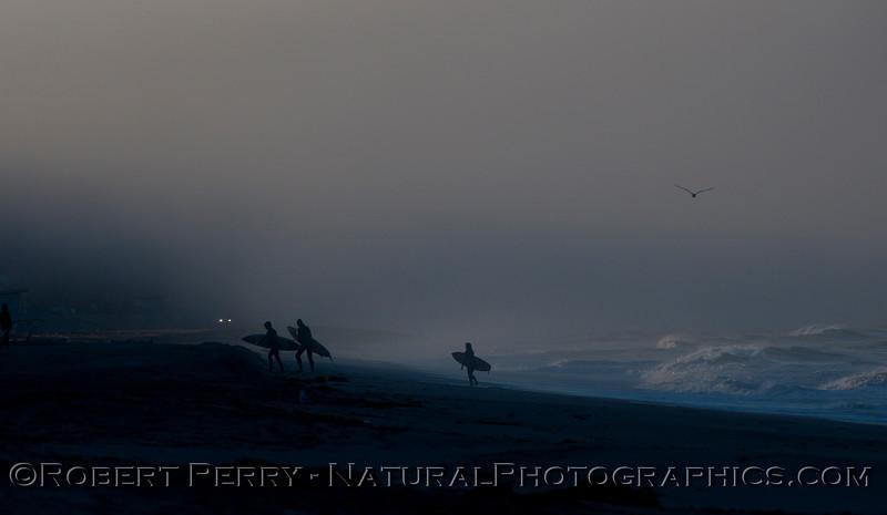 surfers silhouette dawn fog