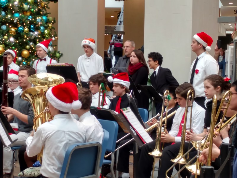 Drew with his trombone and Santa hat