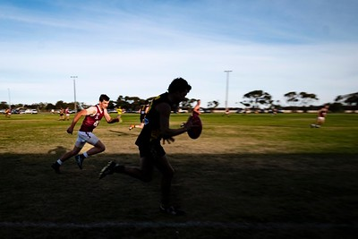 Saturday afternoon football game between Nullawil and Macorna at the Nullawil footy ground, Mallee region, Victoria.