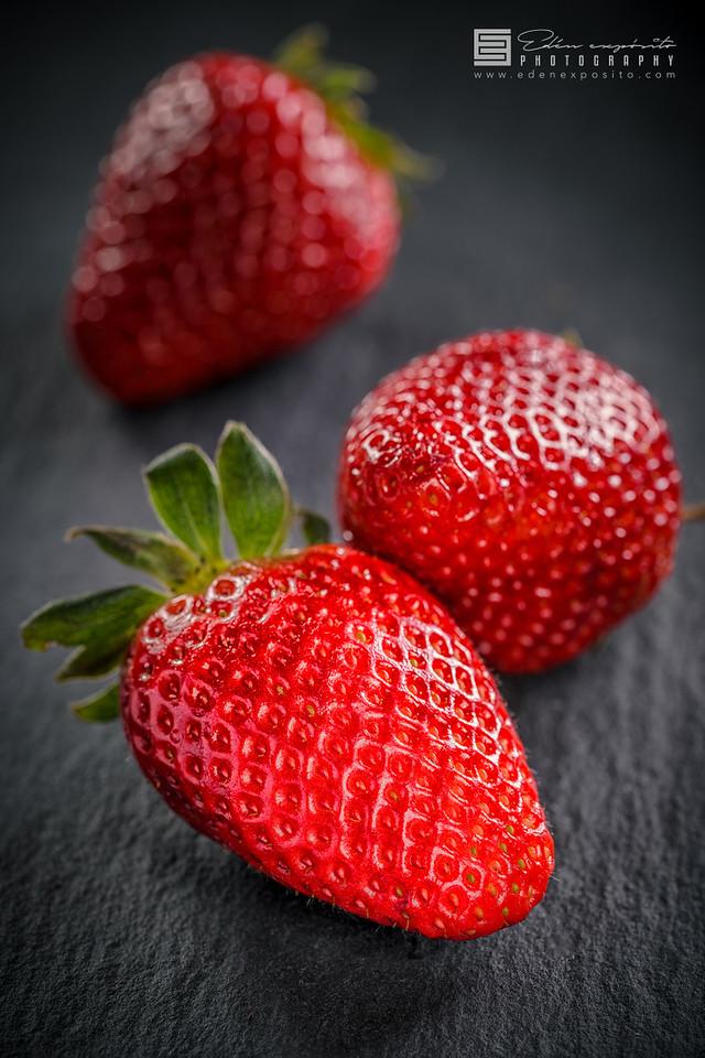 Strawberry on blackboard stone