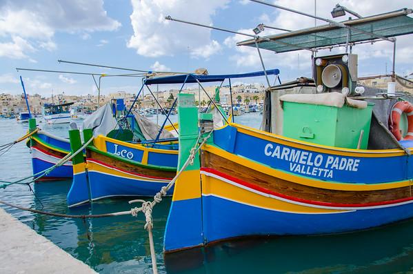 Colorful Maltese fishing boats in Marsaxlokk Harbor, Malta