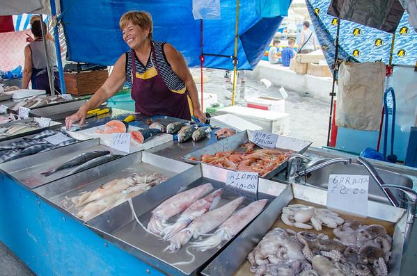 Smiling fish vendors at Marsaxlokk Sunday Market, in Malta