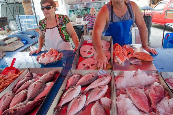 Fresh fish vendors at the Sunday market in Marsaxlokk, Malta