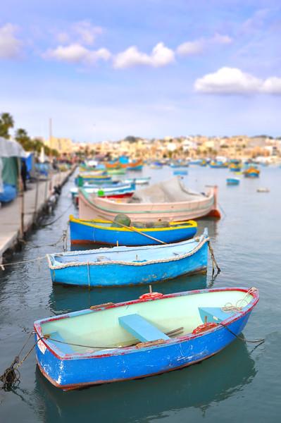 Row Boats Relax in Marsaxlokk Port. 2018.