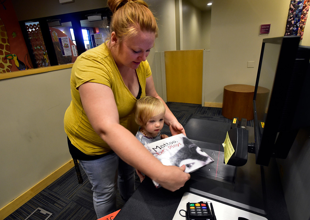 . BROOMFIELD, CO - SEPTEMBER 13 2018 Merissa Shayler and her daughter Nora 14 months at the Mamie Doud Eisenhower Library in Broomfield on Thursday September 13, 2018.  For more photos go to broomfieldenterprise.com (Photo by Paul Aiken/Staff Photographer)