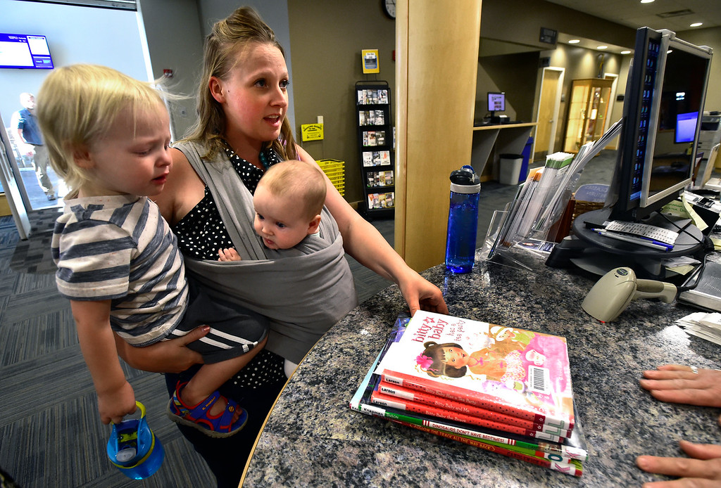 . BROOMFIELD, CO - SEPTEMBER 13 2018 Kabrina Budwell checks out books with her son Ahldenn 2, and daughter Alianah, 5 months at the Mamie Doud Eisenhower Library in Broomfield on Thursday September 13, 2018.  For more photos go to broomfieldenterprise.com (Photo by Paul Aiken/Staff Photographer)