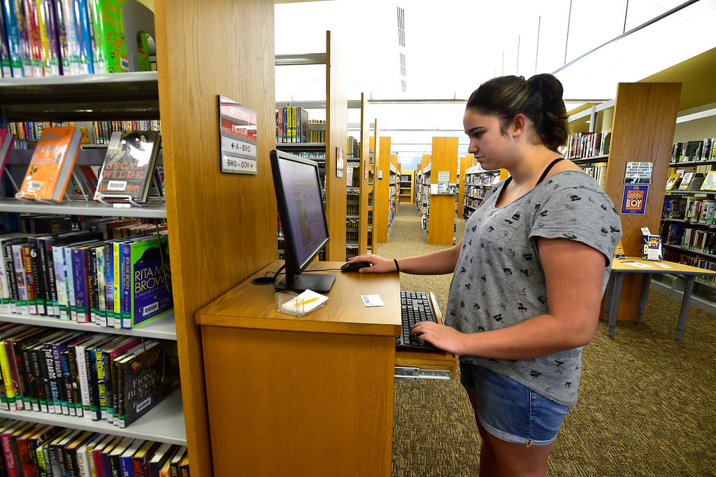 . BROOMFIELD, CO - SEPTEMBER 13 2018 Lexi Raichle uses the computer system to find a book in the Mamie Doud Eisenhower Library in Broomfield on Thursday September 13, 2018.  For more photos go to broomfieldenterprise.com (Photo by Paul Aiken/Staff Photographer)
