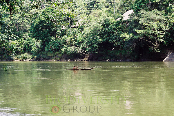Quichua boy in canoe