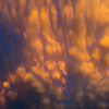 Pronounced mammatus clouds are illuminated by the sun as it dips below the horizon near Adrian, TX, on June 6, 2014.
