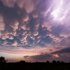 Mammatus clouds make for a spectacular sunset behind severe thunderstorms near Henrietta, TX, on April 22, 2011.