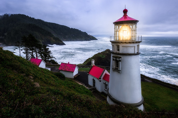 Heceta Head Lighthouse shining bright during stormy weather along the Oregon Coast