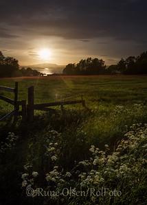Solnedgang over innhegninga