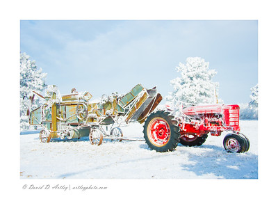 Farmall and Threshing Machine in snow; Monument; CO
