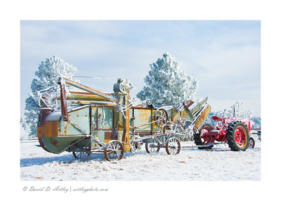 Farmall and Threshing Machine in snow, Monument, CO