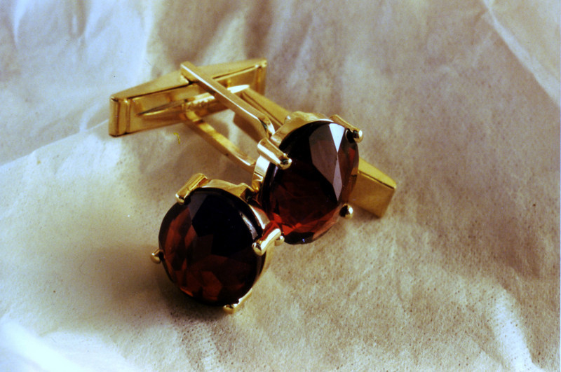 Garnet cufflinks. The garnets were set upside-down to emulate an older garnet look.
