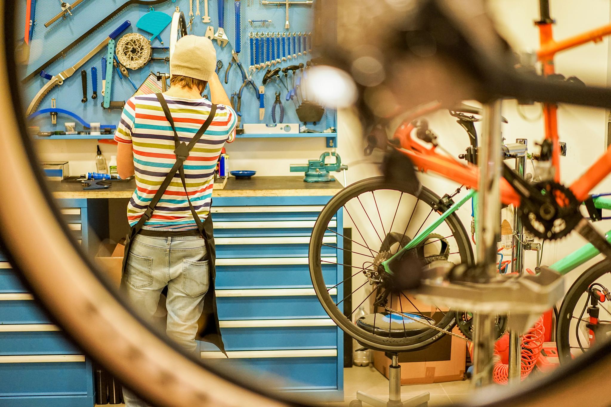 mechanic preparing bicycles in workshop