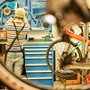 mechanic preparing bicycles in workshop