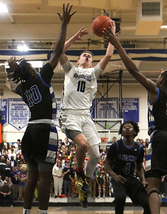 no.10, Ben Roy Manasquan boys basketball v/s Lincoln in Manasquan, NJ on 3/5/19. [DANIELLA HEMINGHAUS | THE COAST STAR]