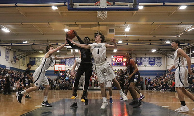 no.11, Quinn Galvin Manasquan boys basketball v/s Lincoln in Manasquan, NJ on 3/5/19. [DANIELLA HEMINGHAUS | THE COAST STAR]