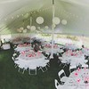 Tent wedding catered by Maneley's.  Our wrap on the tent poles, barn lights and illuminated paper lanterns.