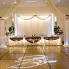 Wedding head table at Maneeley's, South Windsor.  Gobo on the floor, our dance canopy on the ceiling, our decoration on the head table.