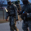 SSG Rembert mentors an Officer Candidate on the leader responsibilities of a Platoon Sergeant during a foot march.
