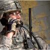 Soldier from Alpha Company, 1st Battalion, 29th Infantry using the AcceleRadio's Dynamic Relay System (DRS) during AEWE Spiral I.  The DRS is a communications network relay that has the ability to link existing tactical radio systems to future systems, regardless of the frequency range or modulation method.