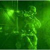 Soldiers from Alpha Company, 1st Battalion 29th Infantry clearing a room as part of a platoon level night attack during AEWE Spiral I at the McKenna Military Operations on Urban Terrain training site at Fort Benning, Georgia.