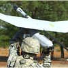 A Soldier from the Alpha Company, 1st Battalion 29th Infantry launching the Skylark I Block 2 small Unmanned Aerial System from Elbit Systems of America during the AEWE Spiral I at Fort Benning, Georgia.