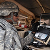 MAJ J.D. Evans, commander of A Company, 1st Battalion, 29th Infantry Regiment, uses the WAVE Communicator Sept. 22 on board a HMMWV. The WAVE Software creates virtual radio channels over a standard data network to establish multi-echelon voice communications between any computer or cell phone in lieu of a dedicated tactical voice radio. A Company is the Maneuver Battle Lab's experiment force, or EXFOR, to test emerging technologies and concepts for the AEWE campaign of experiments, currently in Spiral G at Fort Benning, Ga. Photo by Kristin Molinaro.