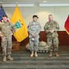 (FORT BENNING, Ga) Maj. Gen. Scott Miller administers the promotion ceremony of SGM Roberto H. Alvarez, Wednesday, August 12, 2015 at Cook Conference room in McGinnis-Wickam Hall.